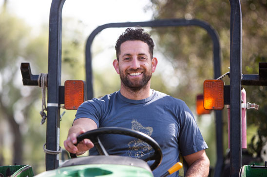 man riding tractor