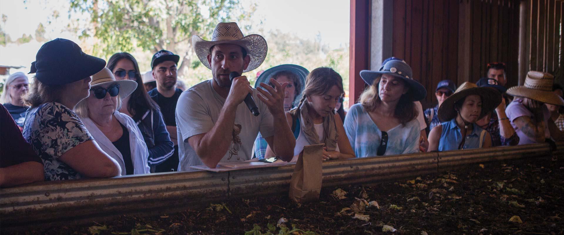 man giving farm tour